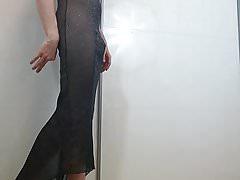 Boy poses barefoot in elegant dress
