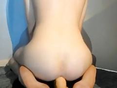 Shaved sissy boi rides big dildo and cums