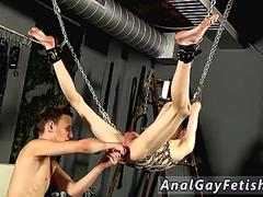Twink is being tied up to a machine and abused by his fellow friend