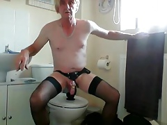 sissy ken rides dildo in chastity and strapon