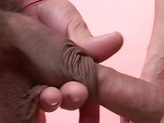 Brunette gay couple enjoy intimate sofa sex session