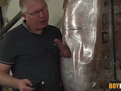 Cameron James getting wrapped in plastic and a hot handjob