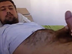 Gorgeous hairy bear jerking off on bed