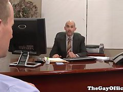 Suited officehunks pounding each other