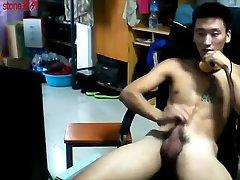 Thai guy tugging dick