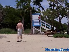Dicksucking jock lifeguard fucked on beach