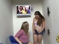 A pair of chicks taking black purple rod at gloryhole