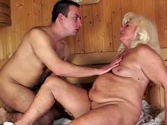 Granny orally pleasured in sauna