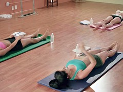 Hot yoga trainer teaching new techniques