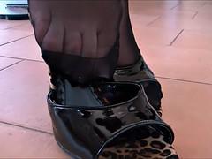 Sexy feet in black nylon