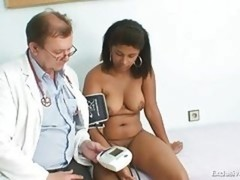Black rotund Manuela gyno exam by white mature doctor