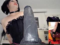 Crossdresser sucks and gags on giant Black Dildo
