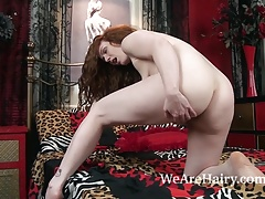 Annie M gets naked and masturbates in bed