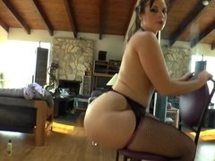 A chick plugs her ass with a dildo and she then does poses