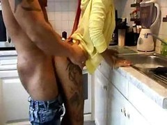 Fine sexual act in the kitchen room from a pair of aroused lovers