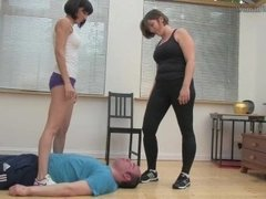 2 British mistresses humiliate their slave at the gym