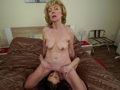 Horny granny has lesbian fun with young girl