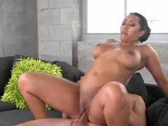 A hot bimbo with large tits is having her pussy penetrated by the dude