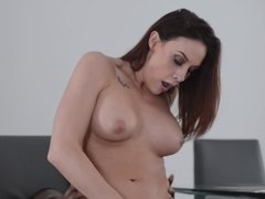 A bimbo that loves cock is sitting down on a big black erection