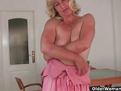 British granny works her old pussy