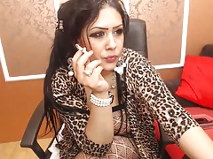 Busty Arab girl in fishnet dances on cam