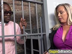 Busty cougar Amber Lynn Bach visits black guy in prison and gets fucked