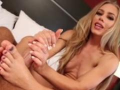 Sexy Nicole Aniston gives her dude a footjob