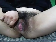 Hairy girl on cam fingering the ass