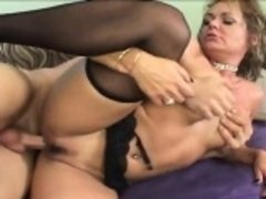 Kinky blonde mom in lingerie fully enjoys her time with a young stud