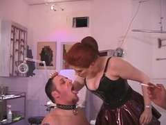 two redhaired Dominatrix torment slave through dick and ball torment and use him as an ash-stand