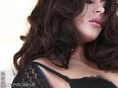 Curvy brunette in classy stockings dildoing pussy