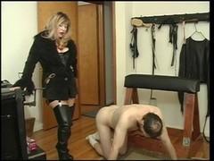 Mistress Cristian spanking her servant fella