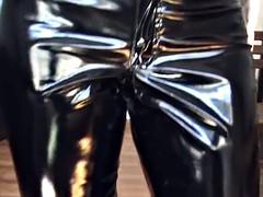 Lady in vinyl pants