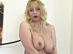 Big breasted British MILF wants your cock between her tits