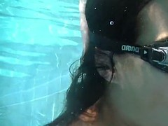 Submerged underwater with a dick inside her