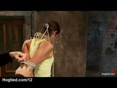 Clothed brunette gal Amber Rayne gets her elbows pinioned & neck rope tie & then her clothes cut off
