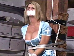 Nurse tied to pole