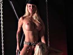 Nazi-bitch dominates busty blonde in chains