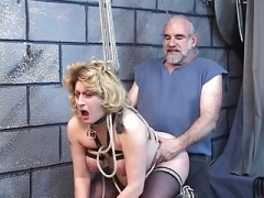 Huge hooter blonde gets captured by her master.