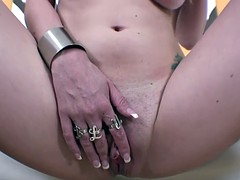 Blonde bitch with natural tits fucks herself with a dildo