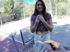 Redhead tweaks her nipples on the tennis court in this hot video