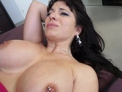 A hot thing with large tits is getting tit fucked by her partner