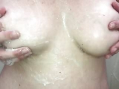 Rubbing her soapy big tits!!