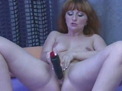 Redhead aged drills her pussy with a dildo