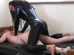 Latex Femdom goddess ass fucks slave