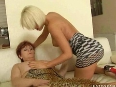 Granny and young blonde having lesby fun