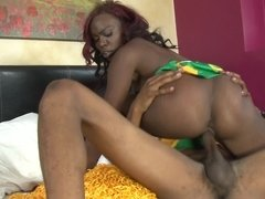 A black slut is on top of her lover, riding his hard dick