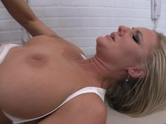 A blonde that has a hot ass is sitting down on a big cock in prison