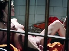 Two lovely babes are doing intimate things in the cell