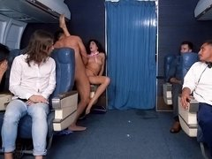 Slutty stewardess fucks a first class flyer as people watch